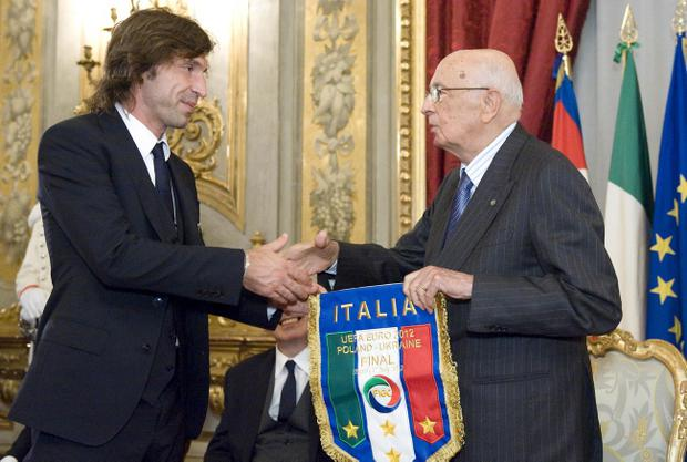 In this photo released by the Italian Presidency Press Office, Italian President Giorgio Napolitano congratulates Andrea Pirlo, midfielder of the Italian soccer team that placed second at the Euro 2012 European Championship, as he received the Italian team at the Quirinale presidential palace in Rome upon their return from Krakow, Poland, Monday, July 2, 2012. (AP Photo/Paolo Giandotti, Italian Presidency)