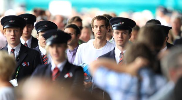 Great Britain's Andy Murray walks through the grounds after practice on day ten of the 2012 Wimbledon Championships at the All England Lawn Tennis Club, Wimbledon