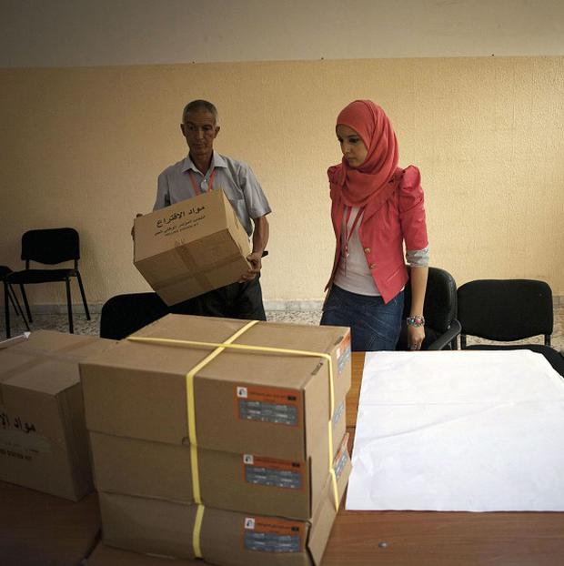 Libyan election officials work at a polling station in Tripoli (AP)
