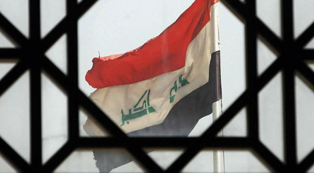 A suicide bomber detonated an explosives-rigged belt at a gathering of his own family in western Iraq