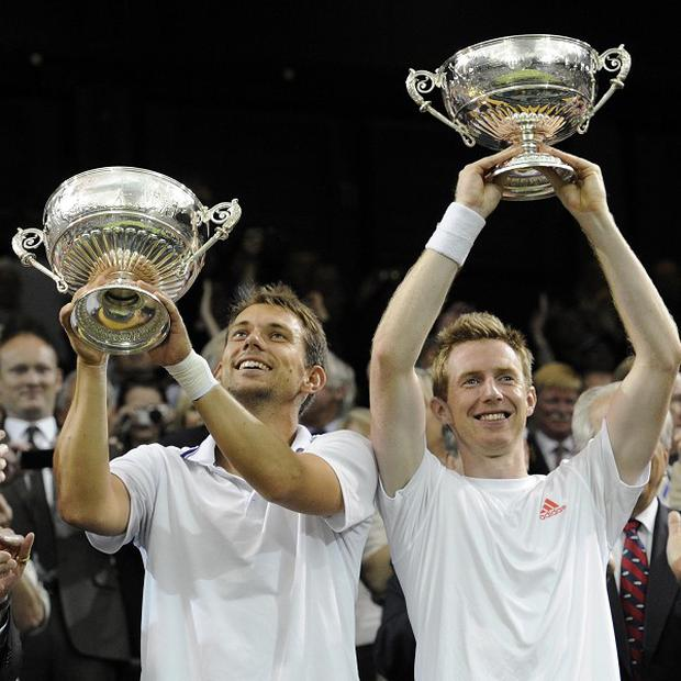 Britain's Jonathan Marray, right, and Denmark's Frederick Nielsen celebrate winning the men's doubles final at Wimbledon