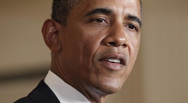 President Barack Obama's election campaign has been hit by weak jobs data (AP)