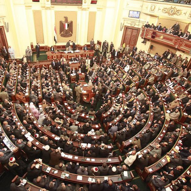 Egyptian president Mohammed Morsi has ordered the return of the country's parliament, which was dissolved by the military (AP)