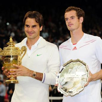 Roger Federer and Andy Murray pose after the men's singles final at Wimbledon