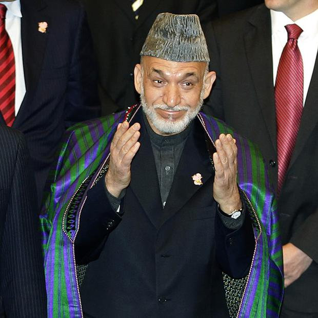 Afghan president Hamid Karzai at the international conference on civilian assistance for his country in Tokyo (AP)