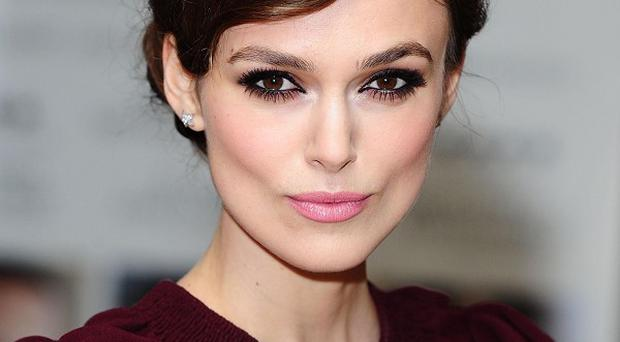 Keira Knightley thinks her latest character is very upbeat