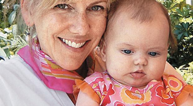 Rielle Hunter with baby Frances, the result of her affair with John Edwards