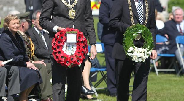 Lord Mayor of Belfast Gavin Robinson, left, and Dublin first citizen Naoise O Muiri lay wreaths at the annual remembrance ceremony