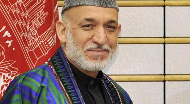 The Taliban routinely targets Afghan government officials to weaken support for president Hamid Karzai's administration (AP)