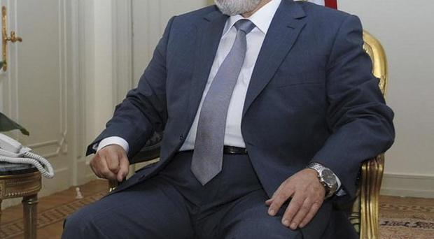 President Mohammed Morsi is engaged in a power struggle with Egypt's generals