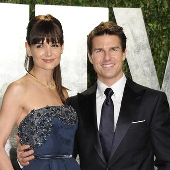 Tom Cruise and Katie Holmes have reached an agreement in their divorce case, according to her attorney (AP)