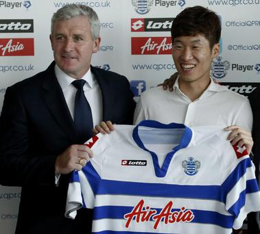 New boy: midfielder Park Ji-sung shows off his new Queen's Park Rangers shirt with manager Mark Hughes