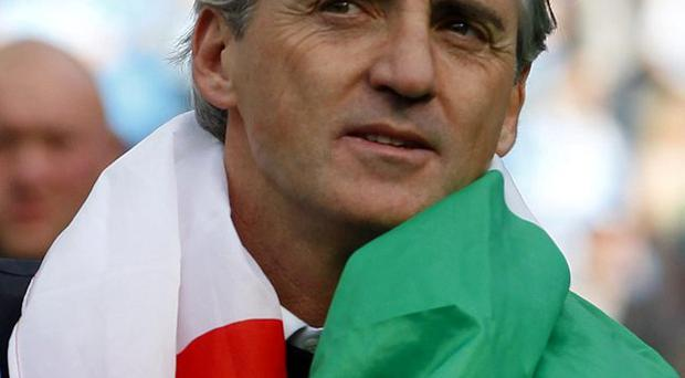 In for the long haul: Mancini has signed new deal at Man City