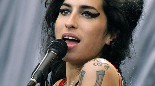 The mother of the late singer Amy Winehouse says that almost a year after her death the grief 'doesn't get any easier'