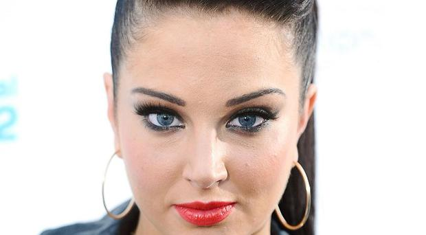 Tulisa Contostavlos' ex Justin Edwards has admitted the publication of a sex tape