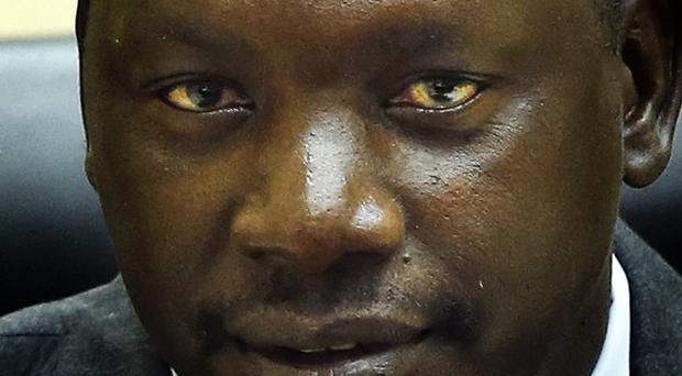 Congolese warlord Thomas Lubanga awaits his sentence in the courtroom of the International Criminal Court in The Hague, Netherlands (AP)