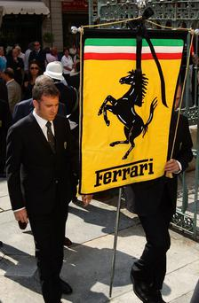 The banner of the Ferrari badge is displayed during Sergio Pininfarina's funeral on July 6, 2012 in Turin, Italy