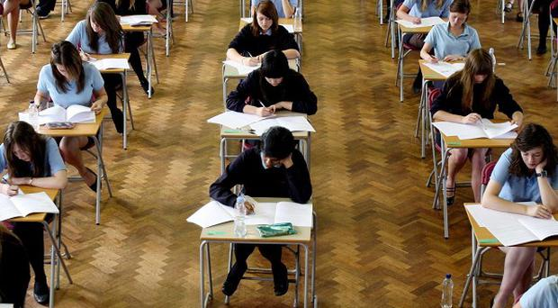 Dozens of exam grades have been changed after an exam board admitted to errors