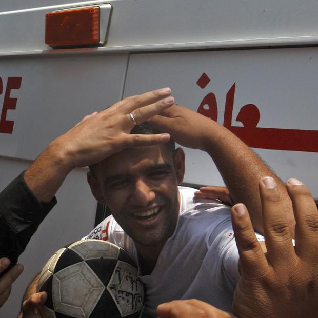 Palestinian Mahmoud Sarsak arrives at al-Shifa hospital in Gaza City after his release from Israeli prison (AP)