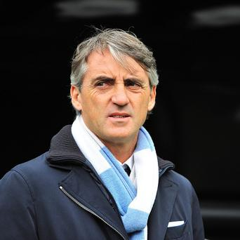 Roberto Mancini led Manchester City to the Premier League title last season