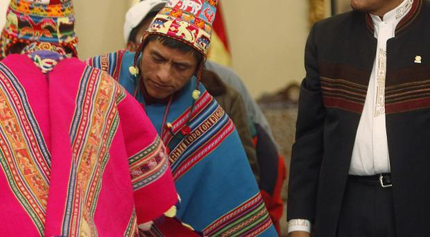 Bolivia's president, Evo Morales, and Quechua Indian leaders at a signing agreement ceremony in La Paz (AP)