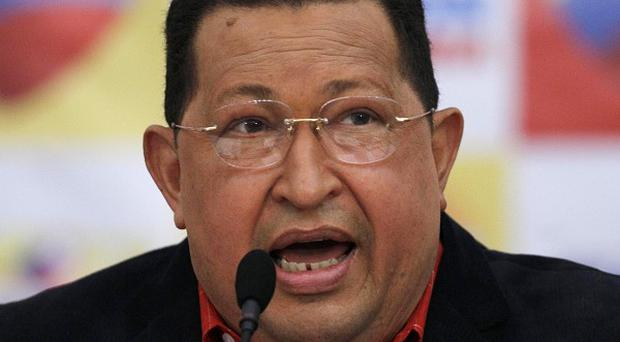 An official calls on allies and adversaries of Hugo Chavez to prevent violence ahead of presidential elections (AP)