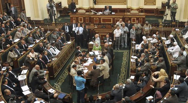 Egyptian speaker Saad el-Katani presides over a brief session of parliament in Cairo (AP)