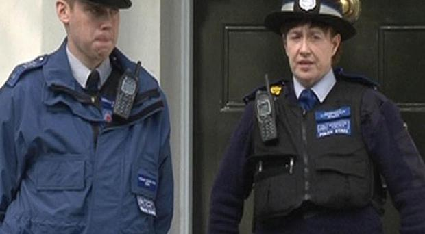 Police outside a house in Cadogan Place, Chelsea, after Eva Rausing, one of the richest women in Britain, was found dead