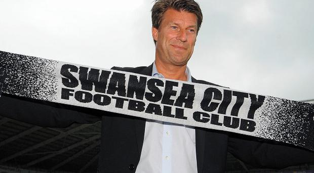 Swansea's new signings are thrilled to be working under Michael Laudrup (pictured) again