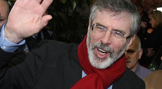 The Taioseach has rejected Gerry Adams' allegations about the health minister's investments