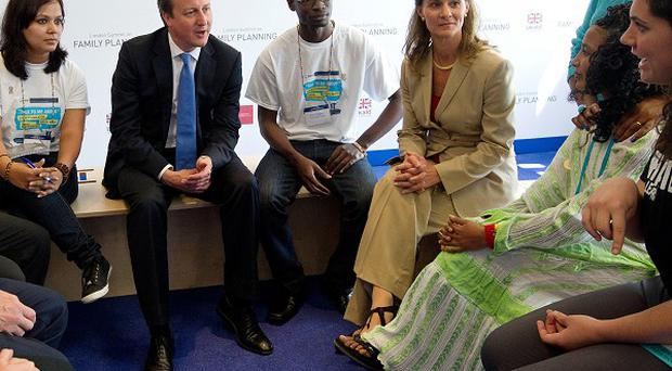 Prime Minister David Cameron with activists during the London Summit on Family Planning