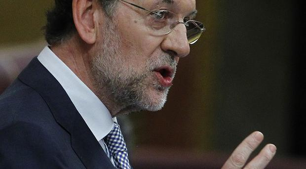 Spain's Prime Minister Mariano Rajoy has announced a £51 billion austerity package(AP)