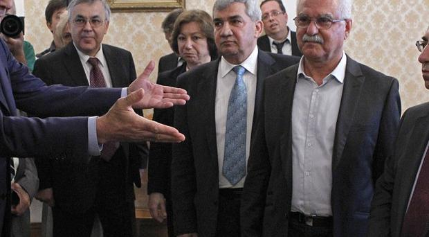 Russian foreign minister Sergey Lavrov, left, welcomes a delegation from the Syrian National Council (AP)