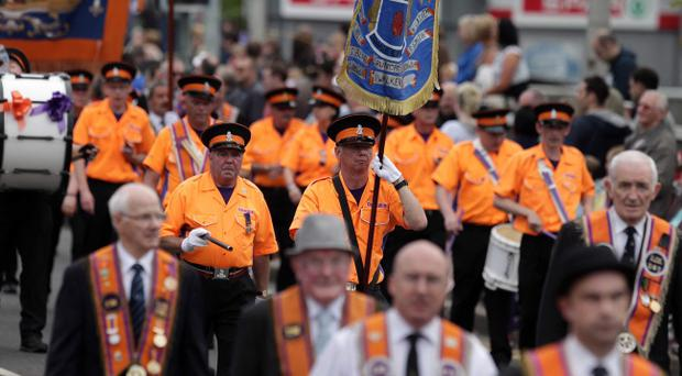 The Orange Order is planning protests over a decision to ban a parade passing a sectarian flashpoint in north Belfast