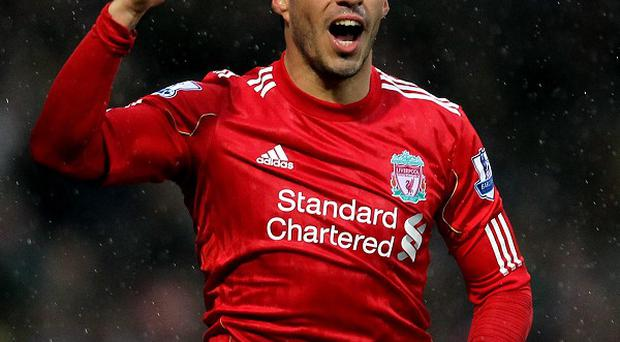 Luis Suarez (pictured) sent Brendan Rodgers a congratulatory text upon getting the Liverpool job