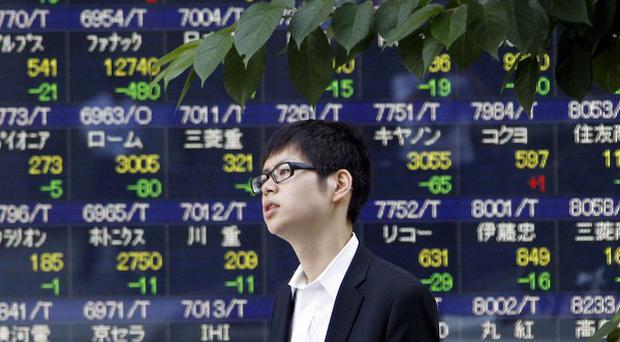 Japan's Nikkei 225 index has fallen along with other Asian stock markets (AP)