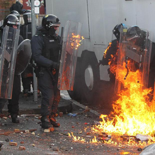 Protesters clash with police in Ardoyne following an Orange Order parade in north Belfast during last year's Twelfth
