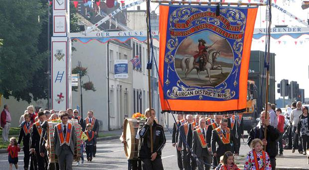 Tamnificarbett Rising Sons of William LOL 17 pass underneath Queen Street arch in Lurgan, on their way to the Co Armagh demonstration in Keady. RicPics. 12/7/12.