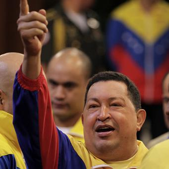 An opposition candidate has accused President Hugo Chavez of seeking to politicise the armed forces in Venezuela (AP)