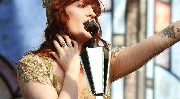 Florence Welch has cancelled a pair of festival gigs to avoid permanently damaging her voice