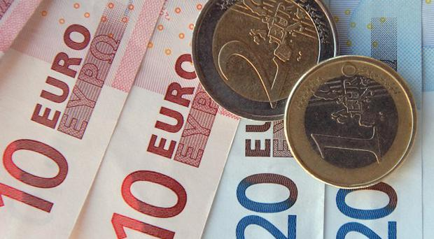 Moody's has downgraded Italy's government bond rating amid problems in the euro zone