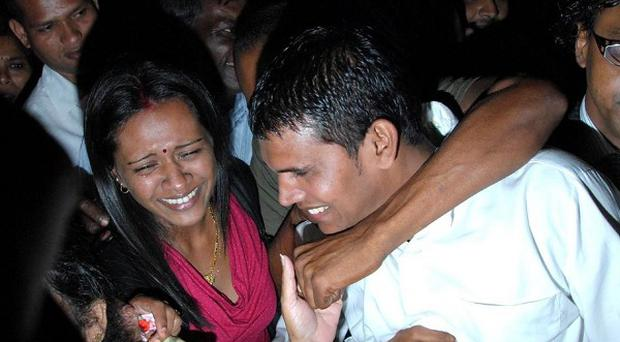 Reshma Treebhoowoon, left, cries as her husband Avinash, right, is acquitted of murdering honeymooner Michaela McAreavey