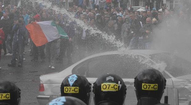 Nationalist protesters clash with police in Ardoyne in north Belfast