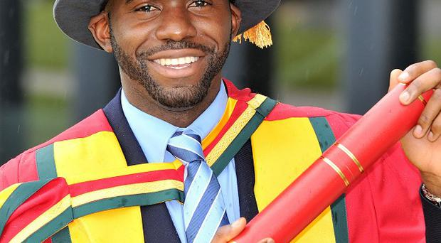 Bolton Wanderers footballer Fabrice Muamba after receiving an Honorary Degree from Bolton University