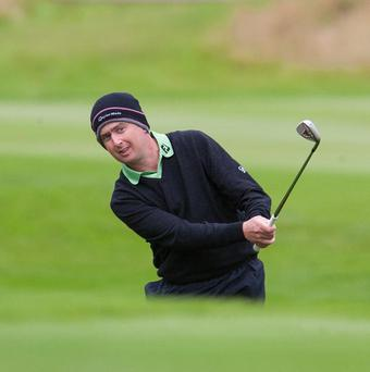 Peter Lawrie, pictured, and Shane Lowry are just three shots behind the leaders