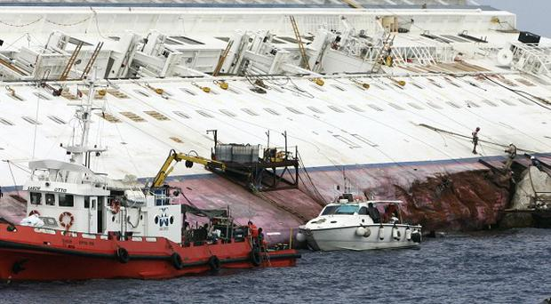 The Costa Concordia capsized off the island of Giglio, Italy, in January (AP)