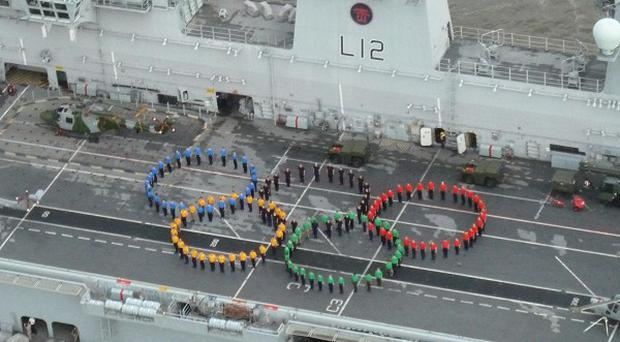 150 sailors and aircrew recreating the Olympic Rings on the flight deck of HMS Ocean