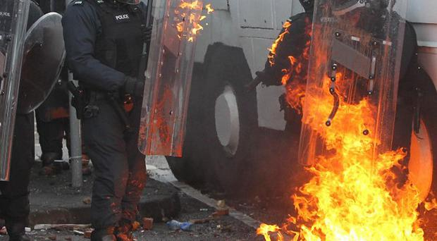 Protesters clash with police in Ardoyne following an Orange Order parade in north Belfast