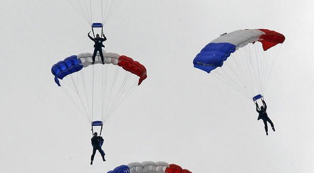 French army paratroopers perform during the traditional Bastille Day parade over the Champs Elysee in Paris (AP)