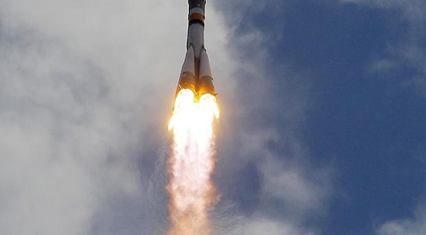 The Soyuz space craft lifts off (AP)